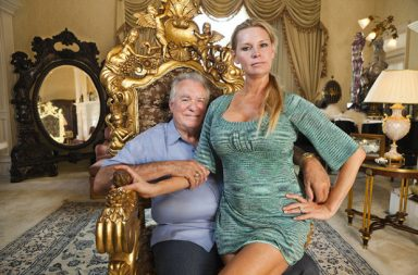 "Billionaire and ""time share king"" David Siegel,  and his former beauty queen wife, Jackie, in the master bedroom of their current 26,000 square foot home in Orlando, Florida.  They loved to buy antiques together and spent 10 years collecting a warehouse full of furniture for the 90,000 square foot palace they were constructing when the financial crisis hit."