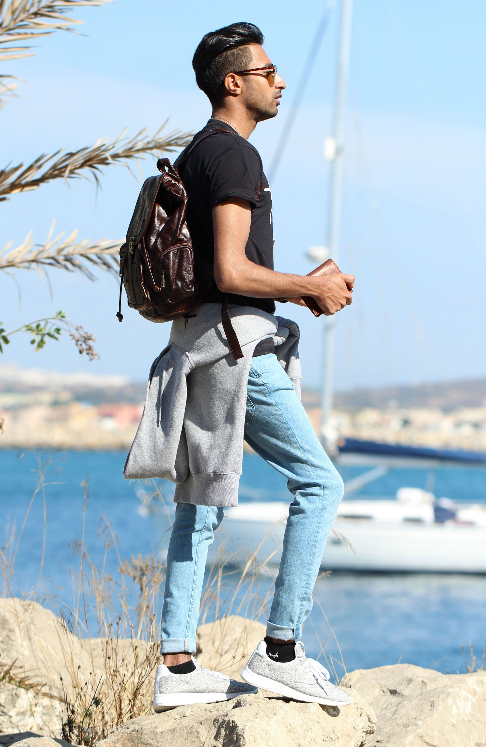 man-in-casual-dress-with-backpack-wallet-and-other-accessories-1600