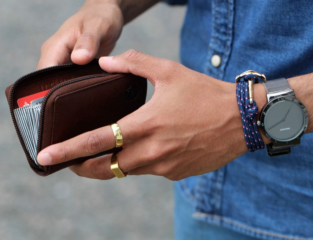 man-with-cardholder-bracelet-and-watch-1600
