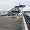 Podívejte se na kdysi slavná a megalomanská olympijská sportoviště: dnes zejí prázdnotou a zmarem - 255e2eea00000578-2941216-the_roof_of_fisht_stadium_has_been_partially_disassembled_costin-a-9_1423222577388